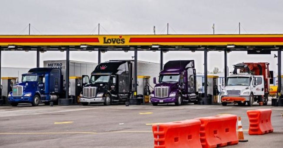 Photo -  Trucks get fuel at the Love's Travel Stop on Morgan Road at Interstate 40. [Chris Landsberger/The Oklahoman]