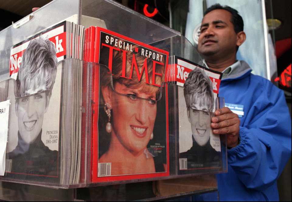 Photo -   FILE - In this Thursday, Sept. 4, 1997, file photo, Cashier Mizan Rahman makes change for a customer from behind a display of the latest news weeklies at the Out of Town News stand in Harvard Square in Cambridge, Mass. Newsweek announced Thursday, Oct. 18, 2012 that it will end its print publication after 80 years and shift to an all-digital format in early 2013. Its last U.S. print edition will be its Dec. 31 issue. The paper version of Newsweek is the latest casualty of a changing world where readers get more of their information from websites, tablets and smartphones. It's also an environment in which advertisers are looking for less expensive alternatives online. (AP Photo/Julia Malakie, File)