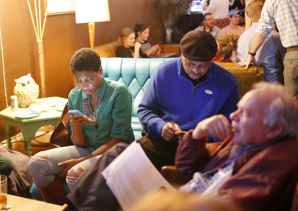 Photo - People watch results of the 2016 Election. Democratic Party supporters gathered Tuesday night at Rockford Cocktail Den in Oklahoma City to await election results in the 2016 presidential contest pitting Hillary Clinton against GOP candidate Donald Trump. Oklahomans on Tuesday also cast votes on several state ballot measures, a host of legislative contests and other local issues and offices. Photo by Sarah Phipps, The Oklahoman