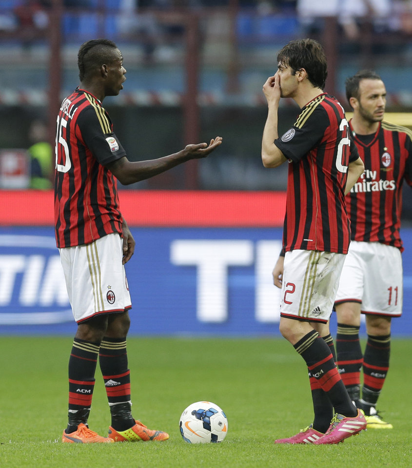 Photo - AC Milan forward Mario Balotelli, left, talks with his teammate Kaka after Parma forward Amauri scored during a Serie A soccer match between AC Milan and Parma, at the San Siro stadium in Milan, Italy, Sunday, March 16, 2014. (AP Photo/Luca Bruno)