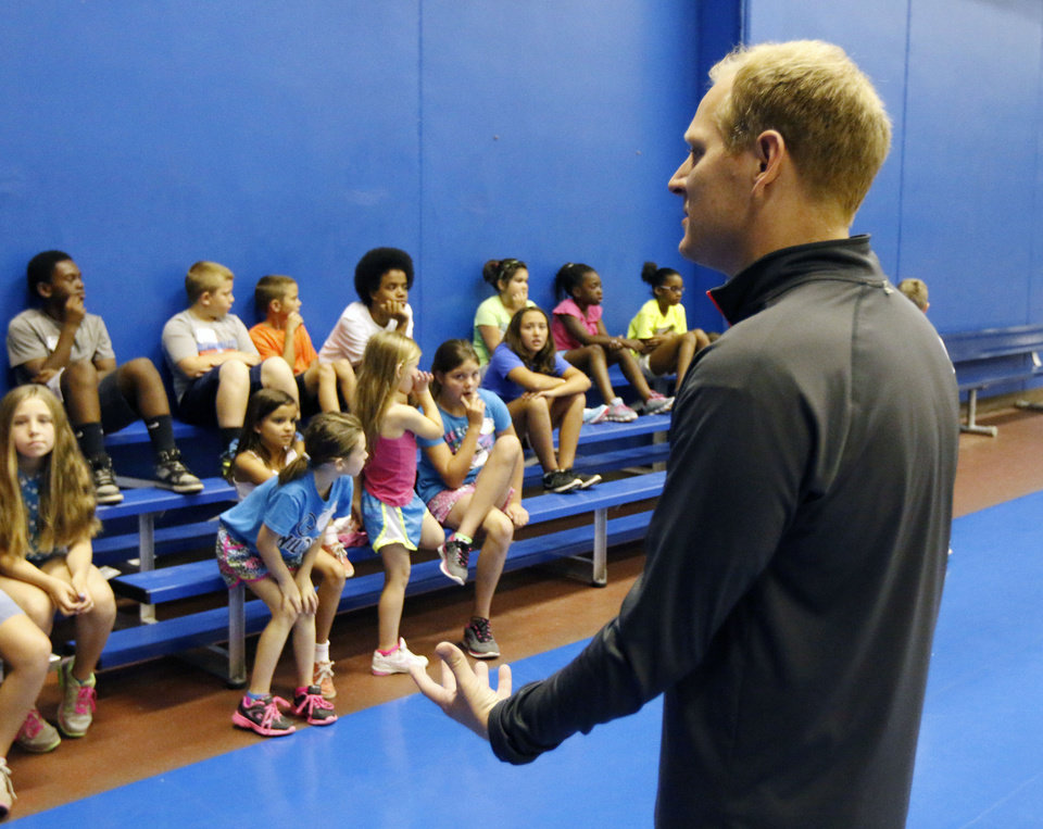 Photo -  John Collings gives game instructions to children during the OCCC Summer Sports Camp on the Oklahoma City Community College campus Monday. Photo by Paul Hellstern, The Oklahoman   PAUL HELLSTERN -  Oklahoman
