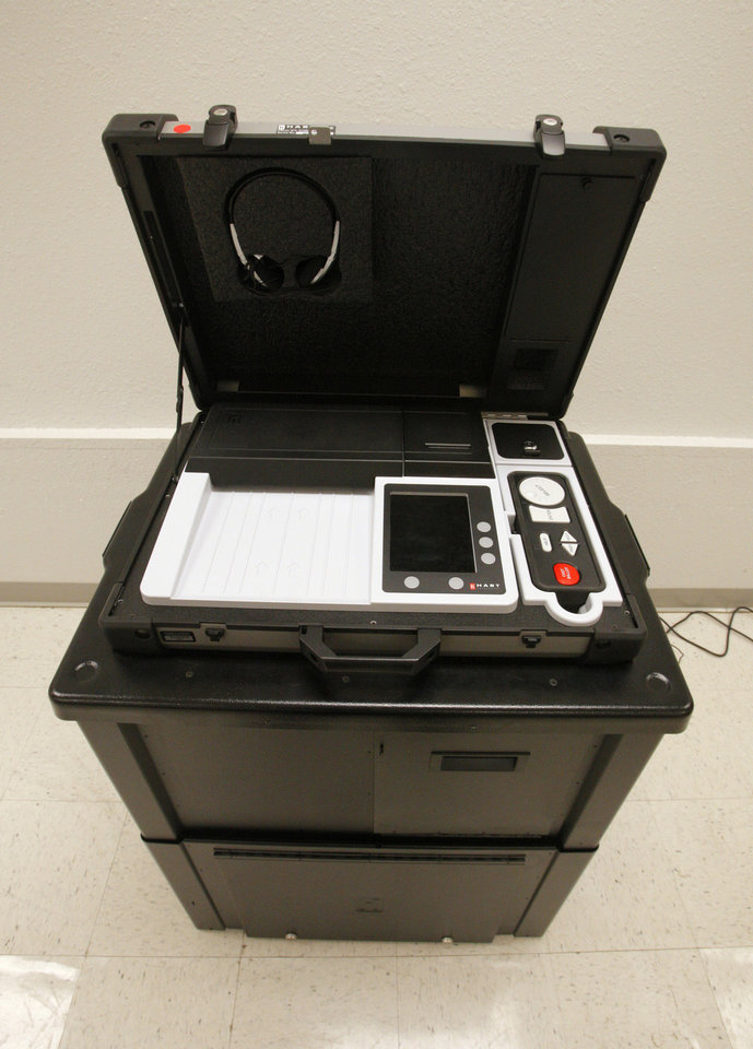 Photo - Oklahomans are encouraged this week to check out the new voting devices at their county election board office.  PAUL B. SOUTHERLAND - THE OKLAHOMAN