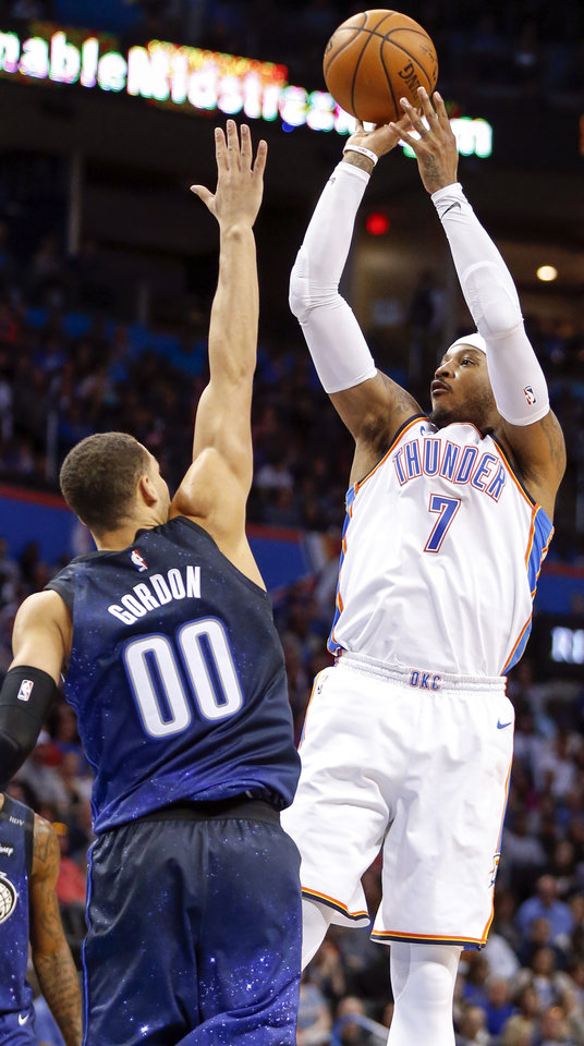 Photo - Oklahoma City's Carmelo Anthony (7) shoots over Orlando's Aaron Gordon (00) during an NBA basketball game between the Oklahoma City Thunder and the Orlando Magic at Chesapeake Energy Arena in Oklahoma City, Monday, Feb. 26, 2018. Photo by Nate Billings, The Oklahoman