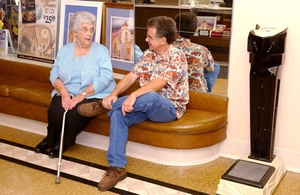 Jane Osborn, member of the Friends of the Coleman, tells Jerry McClanahn from Chandler, Oklahoma, some history of the Coleman Theatre in Miami, Oklahoma Thursday, Oct. 23, 2008. BY GARY CROW, FOR THE OKLAHOMAN