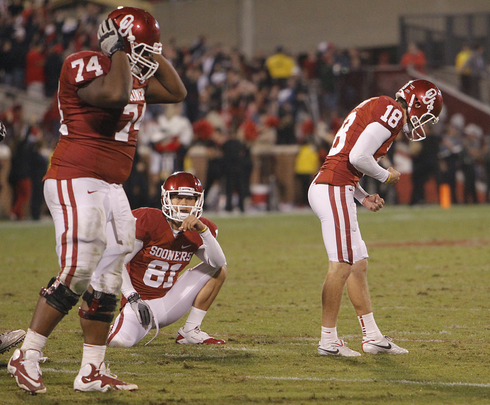 Photo - Oklahoma's Michael Hunnicutt (18) and Adam Shead (74) react after Hunnicutt missed a field goal during the college football game between the University of Oklahoma Sooners (OU) and Texas Tech University Red Raiders (TTU) at the Gaylord Family-Oklahoma Memorial Stadium on Monday, Oct. 24, 2011. in Norman, Okla. Photo by Chris Landsberger, The Oklahoman
