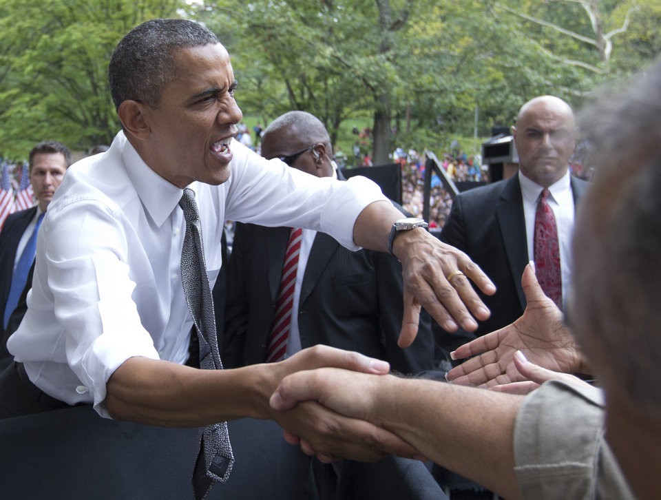 Photo -   President Barack Obama greets people after speaking at a campaign event at Eden Park's Seasongood Pavilion, Monday, Sept. 17, 2012, in Cincinnati, Ohio. (AP Photo/Carolyn Kaster)
