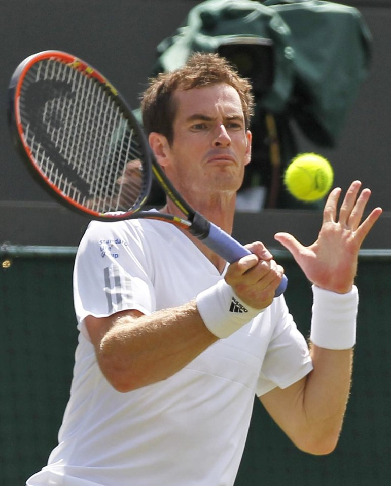 Photo - Defending champion Andy Murray of Britain returns to Biaz Rola of Slovenia during their men's singles match at the All England Lawn Tennis Championships in Wimbledon, London, Wednesday, June 25, 2014. (AP Photo/Sang Tan)