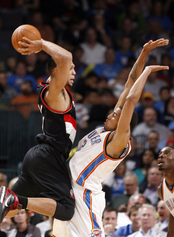 Photo - Oklahoma City's Thabo Sefolosha (2) defends against Portland's Brandon Roy (7) during the NBA game between the Oklahoma City Thunder and the Portland Trail Blazers, Sunday, Nov. 1, 2009, at the Ford Center in Oklahoma City. Photo by Sarah Phipps, The Oklahoman