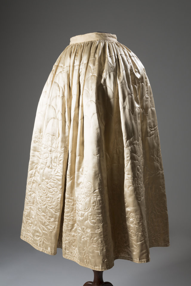 Photo - This image released by The Museum at FIT shows a 1765 English quilted petticoat in silk and satin.  From a 1770 corset to a 2014 bra-and-panty set in lacy stretch silk, the Museum at the Fashion Institute of Technology has taken on lingerie and ladies foundation garments as the focus of a new exhibition. In about 70 pieces,