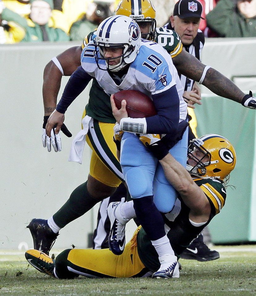 Photo - Green Bay Packers' Clay Matthews sacks Tennessee Titans quarterback Jake Locker (10) during the first half of an NFL football game Sunday, Dec. 23, 2012, in Green Bay, Wis. (AP Photo/Morry Gash)