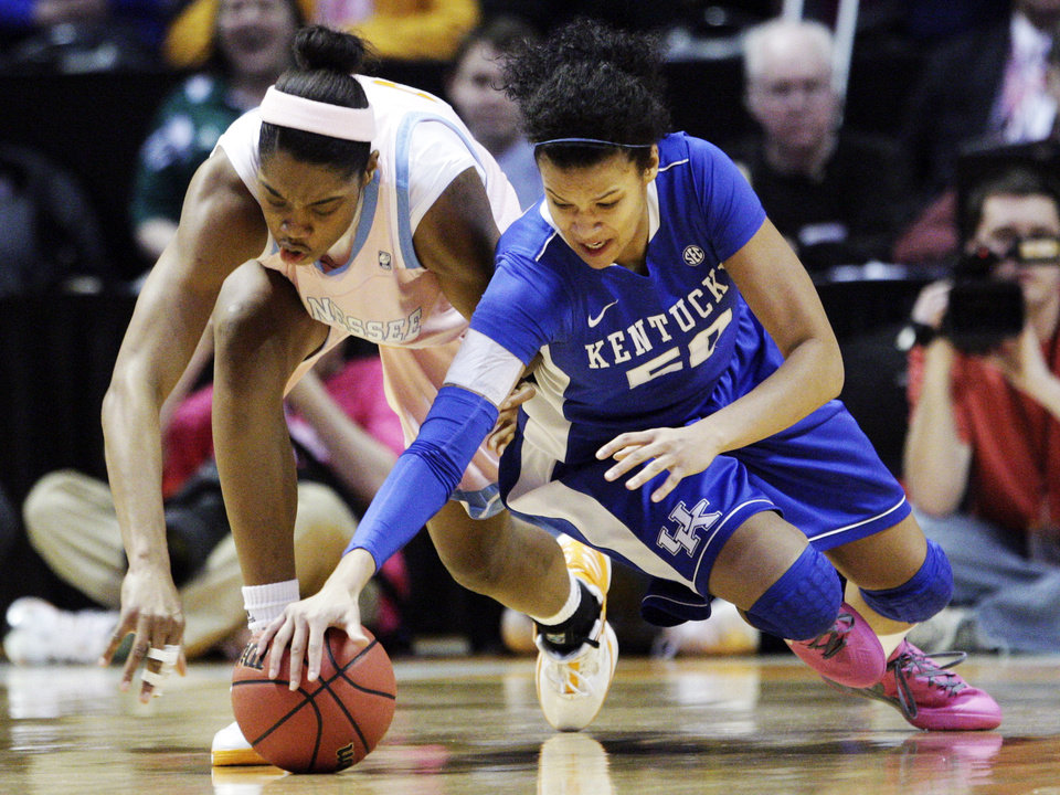 Photo -   Kentucky's Azia Bishop, right, battles for the ball with Tennessee's Vicki Baugh (21) in the first half of an NCAA college basketball game on Monday, Feb. 13, 2012, in Knoxville, Tenn. (AP Photo/Wade Payne)