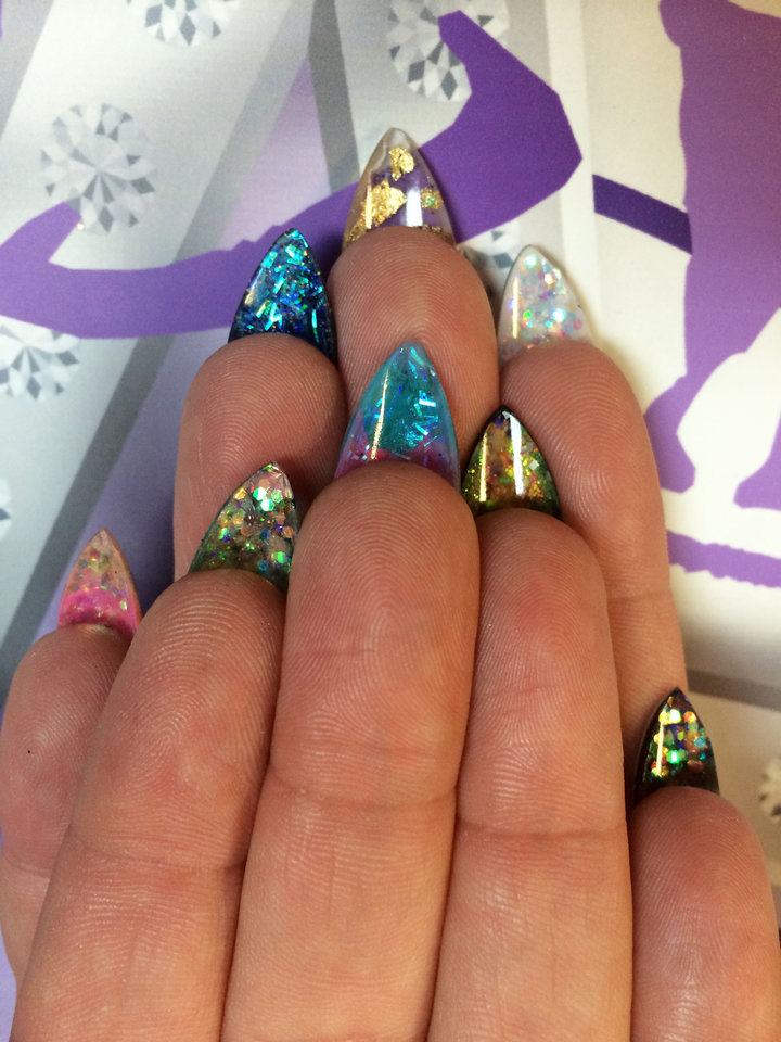 Photo - This product image released by Naja Rickette shows a western fingernail design by nail artist Naja Rickette. Move over, studded bracelets and chandelier earrings. Right now, it's all about nails. Rhinestones, 3-D designs, textured topcoats and new offerings from fashion royalty have upped the ante on fingertips.  (AP Photo/Naja Rickette)