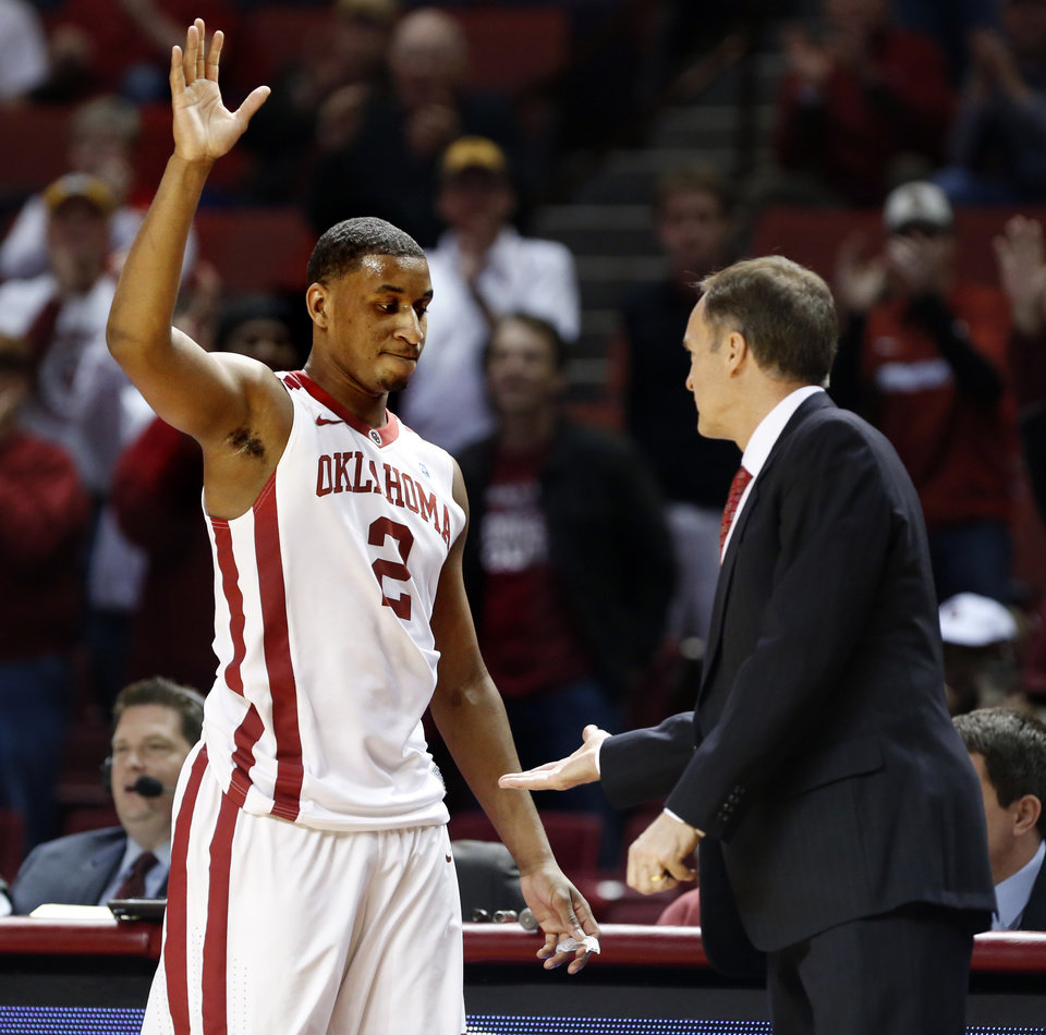 Oklahoma's Steven Pledger (2) waves to the crowd and greets Oklahoma Sooner head coach Lon Kruger near the end of the second half as the University of Oklahoma Sooners (OU) men defeat the Iowa State Cyclones 86-69 in NCAA, college basketball at Lloyd Noble Center on Saturday, March 2, 2013  in Norman, Okla. Photo by Steve Sisney, The Oklahoman