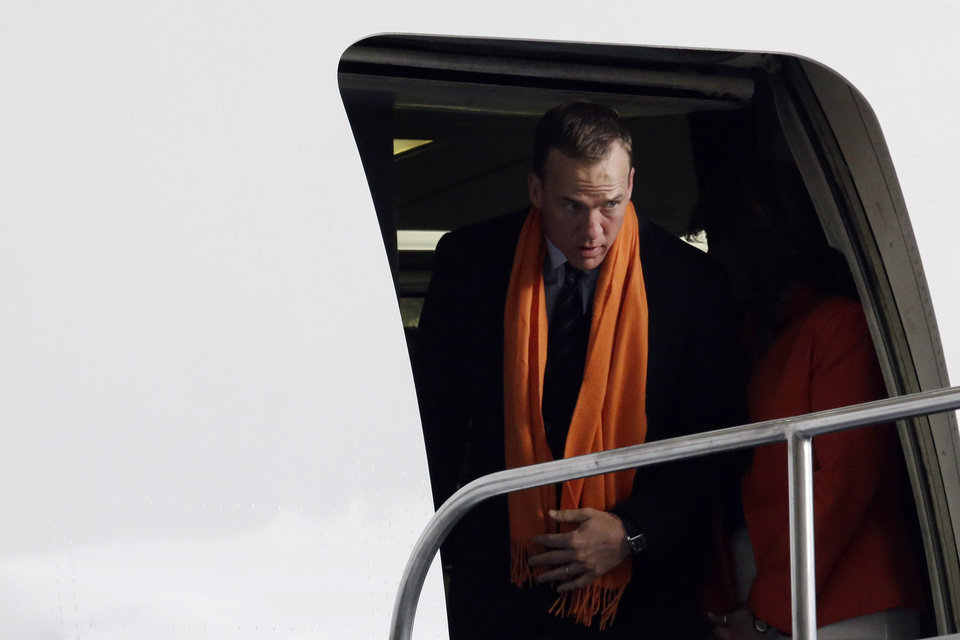 Photo - Denver Broncos' Peyton Manning arrives at Newark Liberty International Airport for the NFL Super Bowl XLVIII football game, Sunday, Jan. 26, 2014, in Newark, N.J. (AP Photo/Julio Cortez)