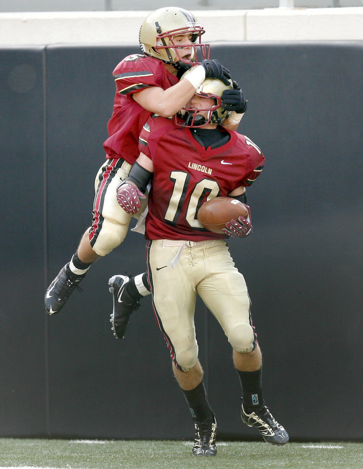Lincoln Christian's Sam Doerner, left, and Roman Wilson celebrate after a touchdown during the Class 2A high school football state championship game between Kingfisher and Lincoln Christian at Boone Pickens Stadium in Stillwater, Okla., Saturday, December 12, 2009.  Photo by Bryan Terry, The Oklahoman