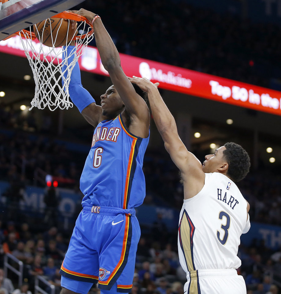 Photo - Oklahoma City's Hamidou Diallo (6) dunks the ball in front of New Orleans' Josh Hart (3) during an NBA basketball game between the Oklahoma City Thunder and the New Orleans Pelicans at Chesapeake Energy Arena in Oklahoma City, Saturday, Nov. 2, 2019. Oklahoma City won 115-104. [Bryan Terry/The Oklahoman]