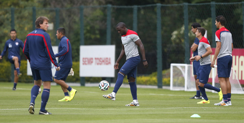 Photo - United States' Jozy Altidore, center, warms up with teammates during a training session at the Sao Paulo FC training center in Sao Paulo, Brazil, Monday, June 9, 2014. The U.S. will play in group G of the 2014 soccer World Cup. (AP Photo/Julio Cortez)