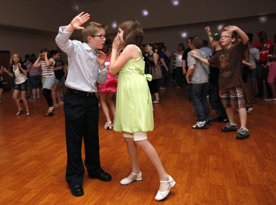 Taylor Lair talks with Brandon Whitney while dancing during the Midwest City Parks and Recreation's Spring Fling dance in Midwest City, Okla., Friday, March 16, 2012. Photo by Sarah Phipps, The Oklahoman.