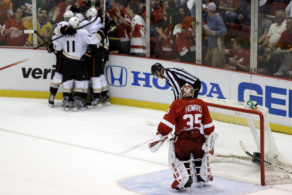 Photo - Detroit Red Wings goalie Jimmy Howard (35) watches as members of the Anaheim Ducks celebrate Bobby Ryan's goal in the third period in Game 6 of a first-round NHL hockey Stanley Cup playoff series in Detroit, Friday, May 10, 2013. (AP Photo/Paul Sancya)