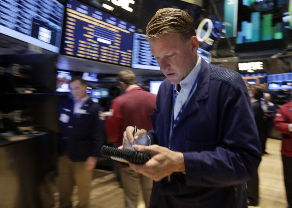 Photo - Trader John Bowers works on the floor of the New York Stock Exchange Friday, Aug. 16, 2013. Stocks bounced back Friday from consecutive days of significant declines, with more evidence of a rebounding U.S. housing market.(AP Photo/Richard Drew)