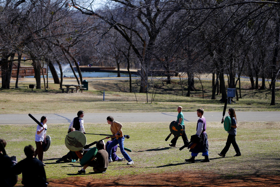 A group of people practice Dagorhir battle games at E.C. Hafer Park. The group meets on Saturdays in the park. PHOTO BY BRYAN TERRY, THE OKLAHOMAN. BRYN TERRY - THE OKLAHOMAN