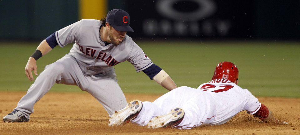 Photo - Los Angeles Angels' Mike Trout, right, steals second base as Cleveland Indians second baseman Jason Kipnis applies the late tag in the third inning of a baseball game Tuesday, April 29, 2014, in Anaheim, Calif. (AP Photo/Alex Gallardo)