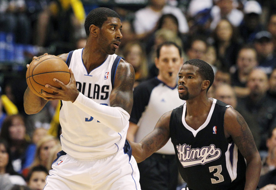 Photo - Dallas Mavericks' O.J. Mayo (32) looks for an opening against Sacramento Kings' Aaron Brooks (3) in the first half of an NBA basketball game Monday, Dec. 10, 2012, in Dallas. (AP Photo/Tony Gutierrez)