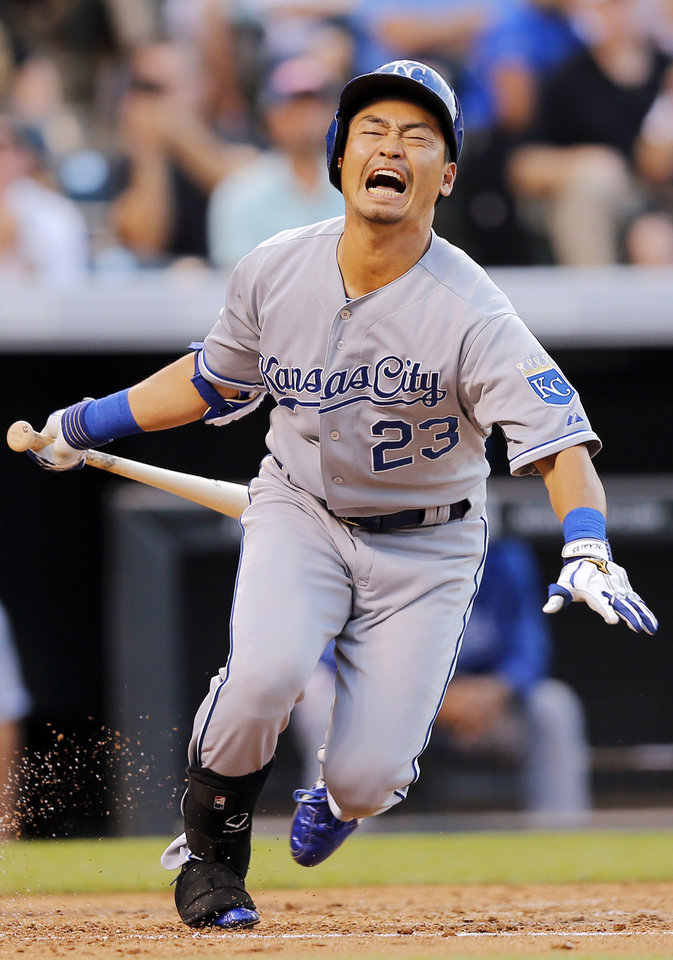 Photo - Kansas City Royals' Norichika Aoki reacts to fouling a ball off his foot against the Colorado Rockies during the third inning of a baseball game Tuesday, Aug. 19, 2014, in Denver. (AP Photo/Jack Dempsey)