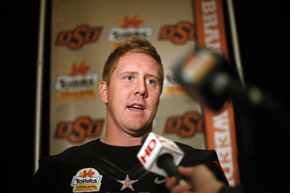 OKLAHOMA STATE UNIVERSITY / OSU / COLLEGE FOOTBALL: Oklahoma State's Brandon Weeden (3) talks to the media during Oklahoma State's  media day for the Fiesta Bowl at the Camelback Inn in Paradise Valley, Ariz.,  Friday, Dec. 30, 2011. Photo by Sarah Phipps, The Oklahoman