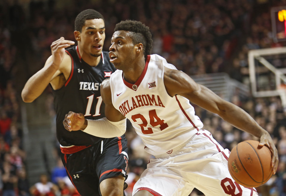 Photo - Oklahoma's Buddy Hield dribbles the ball past Texas Tech's Zach Smith during the first half of an NCAA college basketball game on Wednesday, Feb. 17, 2016 in Lubbock, Texas. (AP Photo/Brad Tollefson)