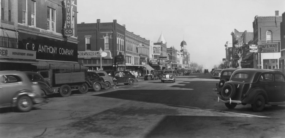 STREET SCENES / EL RENO:  On the left hand side of Bickford Avenue, looking north is the C.R. Anthony company store, Crown Drug, Higgs Shop, Rector Hardware, El Reno Theatre, Firestone Tire, Patterson Drug, First National Bank, Timberlake's Book Store, Conservative Investment Company, The El Reno American and the Oklahoma Natural Gas company.
