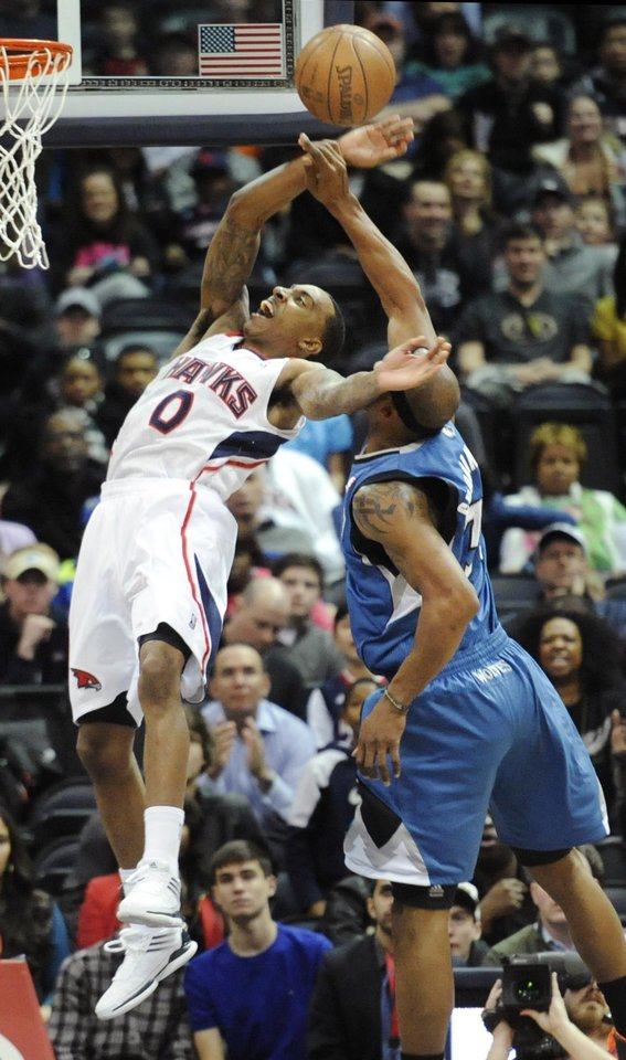 Atlanta Hawks point guard Jeff Teague (0) is fouled flagrantly by Minnesota Timberwolves forward Dante Cunningham as he goes to the basket during the final moments of an NBA basketball game in Atlanta, Monday, Jan. 21, 2013. Atlanta won 104-96. (AP Photo/John Amis)