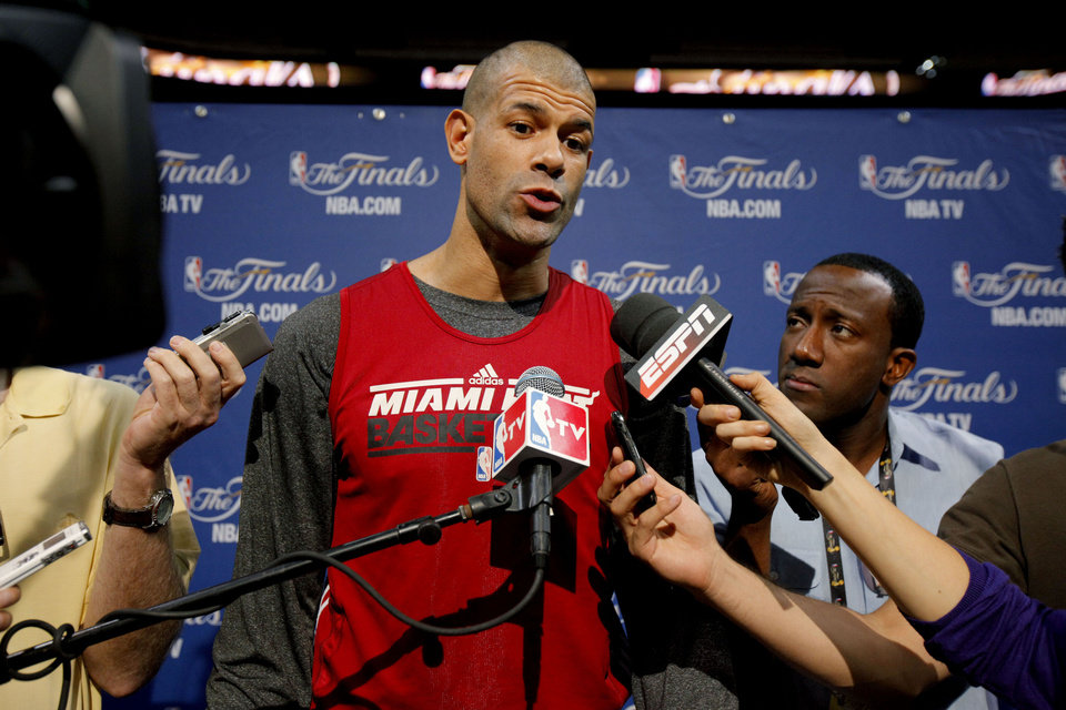 Photo - Miami's Shane Battier answers a question during a press conference for Game 3 of the NBA Finals between the Oklahoma City Thunder and the Miami Heat at American Airlines Arena in Miami, Saturday, June 16, 2012. Photo by Bryan Terry, The Oklahoman