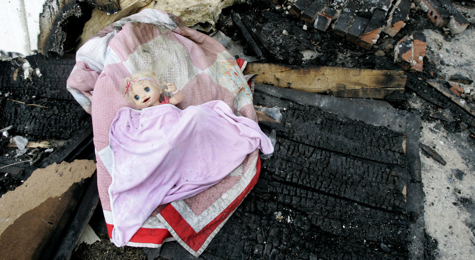 Photo - This doll survived the house fire at 599 Fern Lane that was destroyed in a wildfire in Choctaw, Oklahoma April 10, 2009.  Photo by Steve Gooch, The Oklahoman