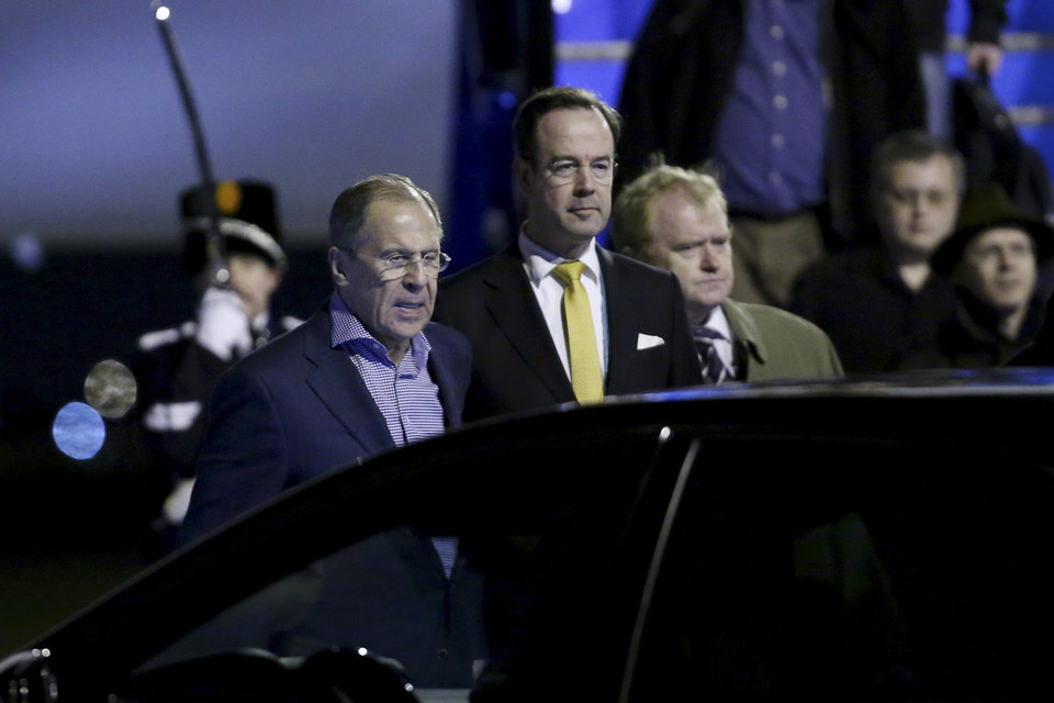 Photo - Russian Foreign Minister Sergey Lavrov, left, arrives at Schiphol Amsterdam airport, Netherlands, Sunday March 23, 2014, one day ahead of the March 24 and 25 Nuclear Security Summit. (AP Photo/Sean Gallup, Pool)