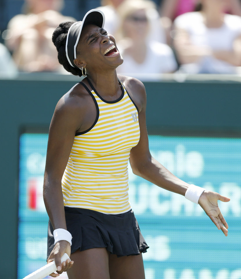 Photo - Venus Williams reacts during her match against Eugenie Bouchard, of Canada,  during the Family Circle Cup tennis tournament in Charleston, S.C., Thursday, April 3, 2014. (AP Photo/Mic Smith)