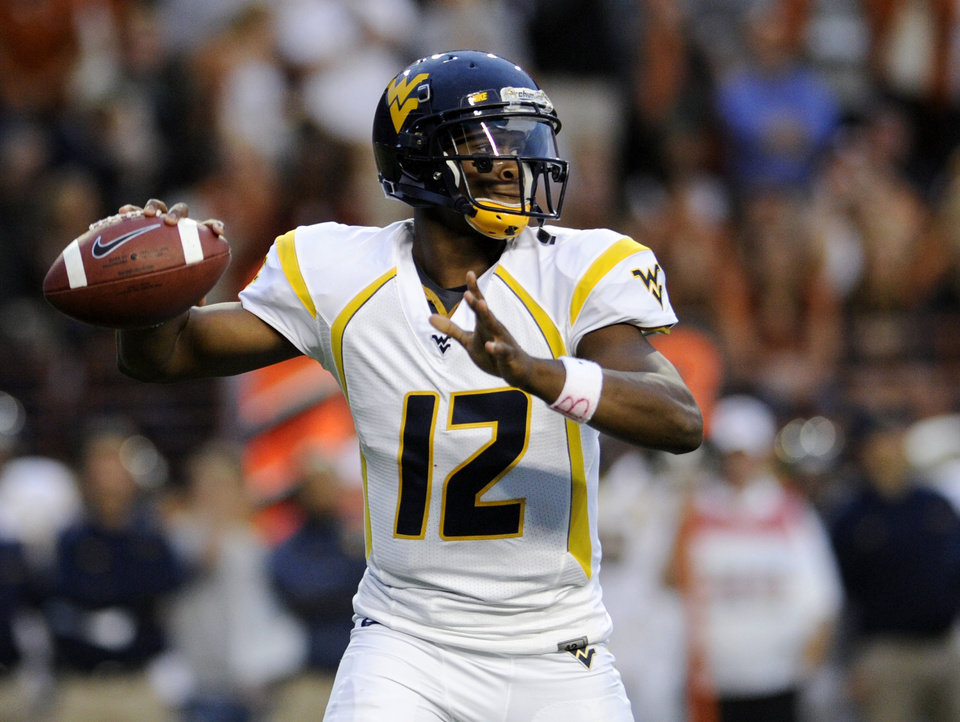 West Virginia quarterback Geno Smith looks for a receiver during the first quarter against Texas during an NCAA college football game Saturday, Oct. 6, 2012, in Austin, Texas. (AP Photo/The Daily Texan, Elisabeth Dillon)