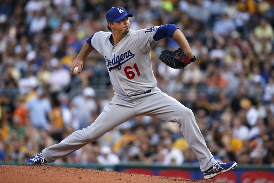 Photo - Los Angeles Dodgers starting pitcher Josh Beckett (61) delivers during the first inning of a baseball game against the Pittsburgh Pirates in Pittsburgh Tuesday, July 22, 2014. (AP Photo)