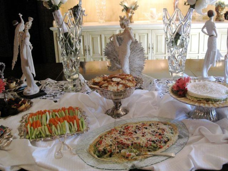Judy Love's  dining room table was filled with cheese spreads, cheese tortes, crackers and breads and trays of vegetables.  (Photo by Helen Ford Wallace).