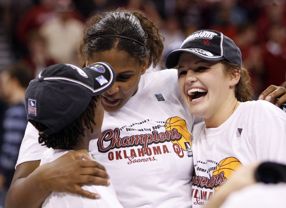 Photo - Courtney Paris (center) hugs Danielle Robinson (left) and Whitney Hand after the team's 74-68 win as the University of Oklahoma (OU) defeats Purdue in the NCAA women's basketball regional tournament finals at the Ford Center in Oklahoma City, Okla., on Tuesday, March 31, 2009.  Photo by Steve Sisney, The Oklahoman