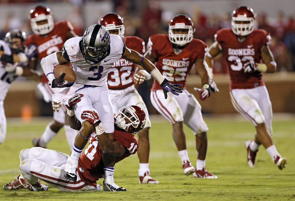 Photo - Oklahoma's Lacoltan Bester (11) stops TCU 's Brandon Carter (3) on a kick return during the college football game between the University of Oklahoma Sooners (OU) and the Texas Christian University Horned Frogs (TCU) at the Gaylord Family-Oklahoma Memorial Stadium on Saturday, Oct. 5, 2013 in Norman, Okla.   Photo by Chris Landsberger, The Oklahoman