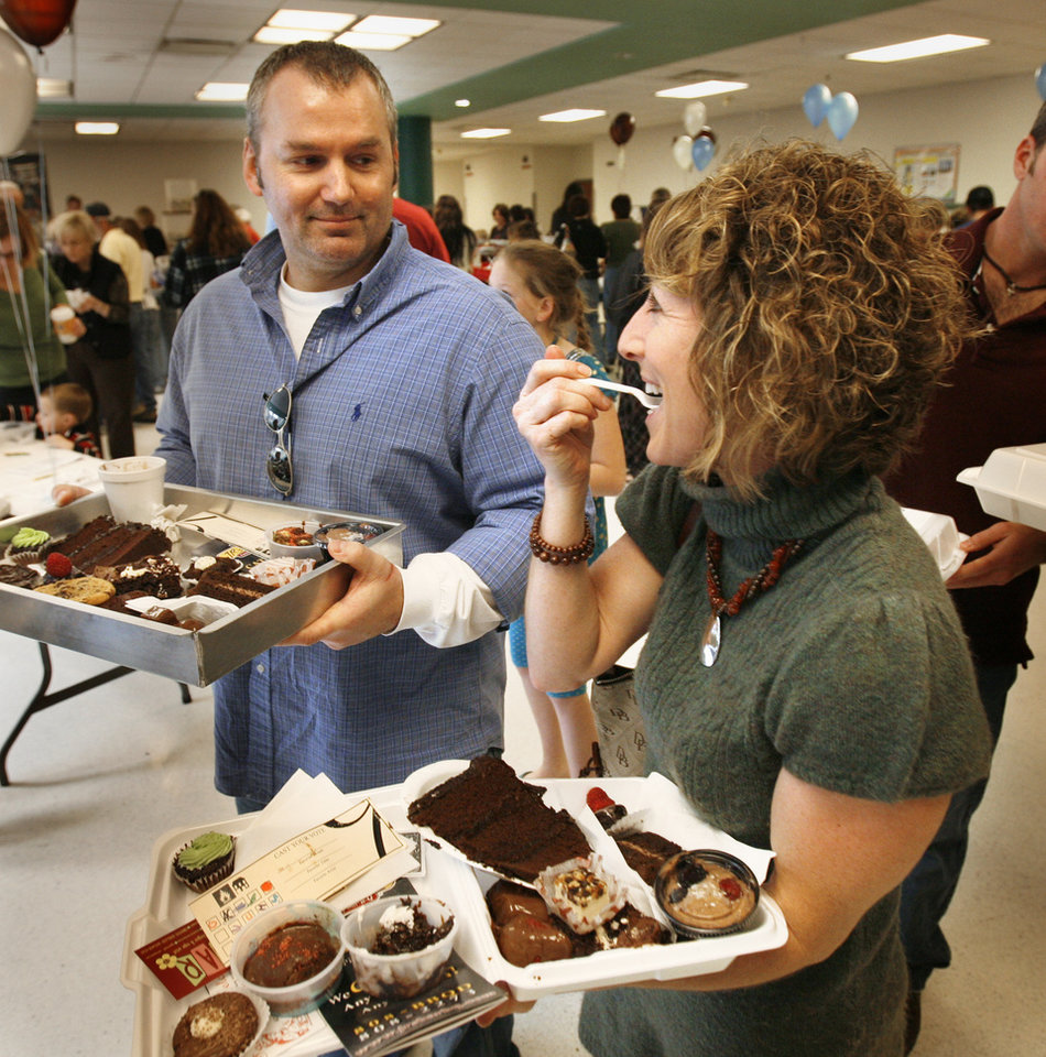 Photo - Greg and Lynn Partney of Claremore participate in the 27th Annual Chocolate Festival benefiting the Firehouse Art Station in Norman, Okla. on Saturday, Feb. 7, 2009.   Photo by Steve Sisney, The Oklahoman