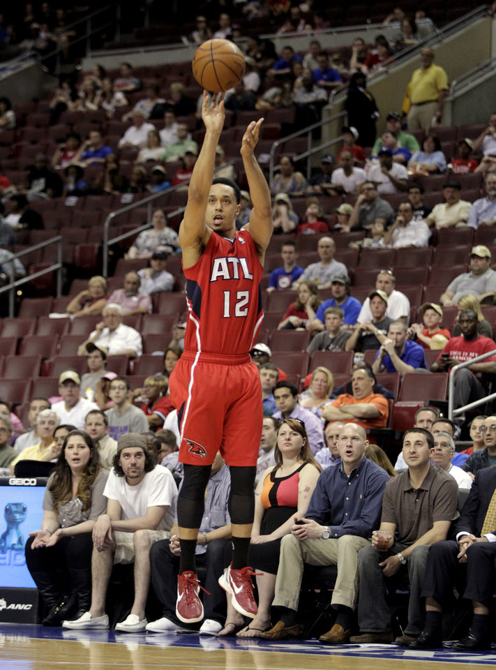 Photo - Atlanta Hawks' John Jenkins (12) shoot against the Philadelphia 76ers in the first half of an NBA basketball game, Wednesday, April 10, 2013, in Philadelphia. (AP Photo/H. Rumph Jr)