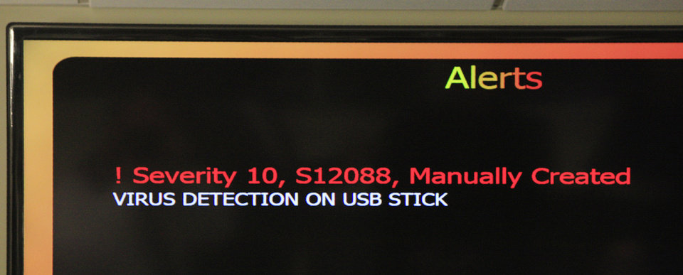 Photo - A test screen shows the type of  alert message that goes out to analysts at the state Security Operations Center when a serious virus threat is detected on any one of about 30,000 computers that are part of the state network. A siren also sounds. Photo by Paul B. Southerland, The Oklahoman  PAUL B. SOUTHERLAND