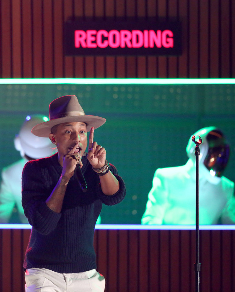 Photo - Pharrell Williams performs at the 56th annual Grammy Awards at Staples Center on Sunday, Jan. 26, 2014, in Los Angeles. (Photo by Matt Sayles/Invision/AP)