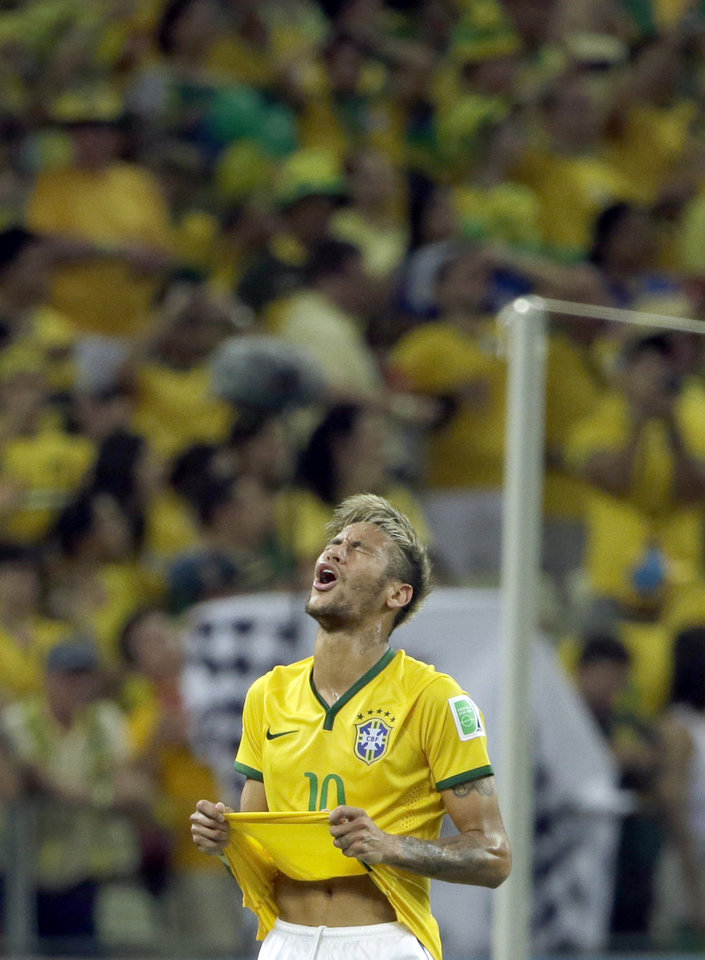 Photo - Brazil's Neymar reacts after missing a chance to score during the World Cup quarterfinal soccer match between Brazil and Colombia at the Arena Castelao in Fortaleza, Brazil, Friday, July 4, 2014. (AP Photo/Hassan Ammar)