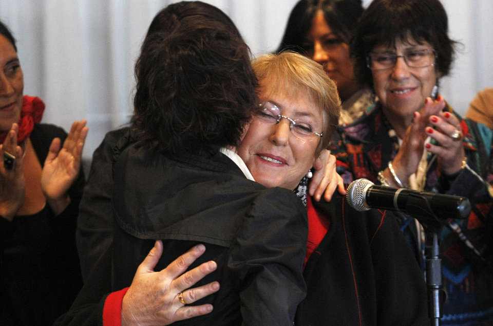 Chile's former President Michelle Bachelet is embraced by Santiago Mayor Carolina Toha during a welcome ceremony at the Arturo Merino Benitez International Airport in Santiago, Chile, Wednesday, March 27, 2013. Bachelet has returned to the South American country after ending a two-year stint heading the U.N. women's agency in New York. She landed in the capital Wednesday amid wide speculation she'll run for president again this year. (AP Photo/Luis Hidalgo)