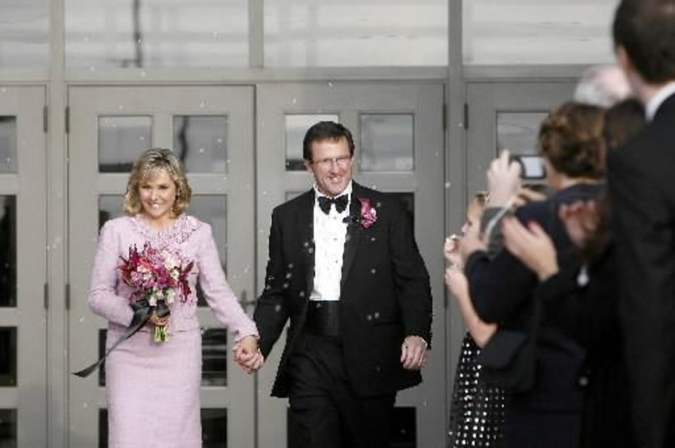 Photo - U.S. Rep.  Mary  Fallin and Wade Christensen leave Crossings Community Church following their wedding, Saturday, Nov. 21, 2009, in Oklahoma City. Photo by Sarah Phipps, The Oklahoman