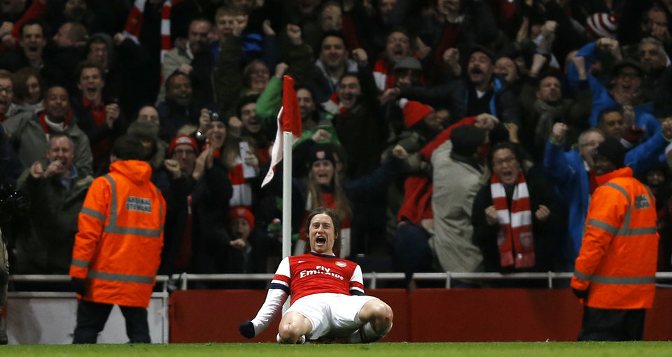 Photo - Arsenal's Tomas Rosicky celebrates after scoring his sides second goal during the English FA Cup third round soccer match between Arsenal and Tottenham Hotspur at the Emirates Stadium in London, Saturday, Jan. 4, 2014. (AP Photo/Kirsty Wigglesworth)