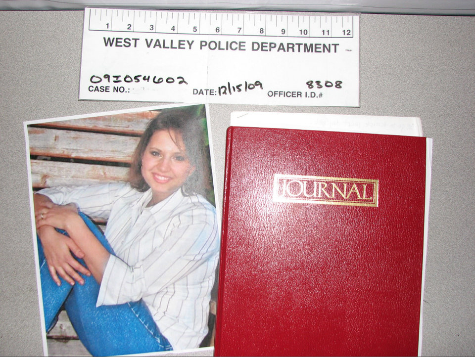 Photo - This evidence photo released Monday, May 20, 2013, by the West Valley City Police Department shows a journal collected from Josh and Susan Powell's house. Citing a lack of leads, a police agency said Monday that it is closing the active investigation of the disappearance of Susan Powell, a Utah mother whose now-dead husband was a prime suspect. West Valley City police called the news conference to offer new details in the case that's been largely kept under wraps since Powell vanished in 2009. The announcement came after police spent two days searching in rural Oregon last week for any trace of Powell's body.  (AP Photo/West Valley City Police Department )